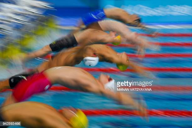 TOPSHOT Athletes compete during the swimming men's 100m backstroke final during the 2018 Gold Coast Commonwealth Games at the Optus Aquatic Centre in...