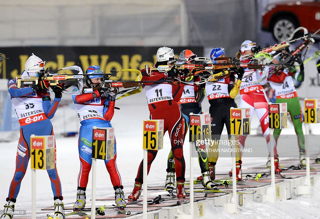 Athletes compete during the Women 10km Pursuit race of the Biathlon World Cup in Ostersund on December 2, 2012.