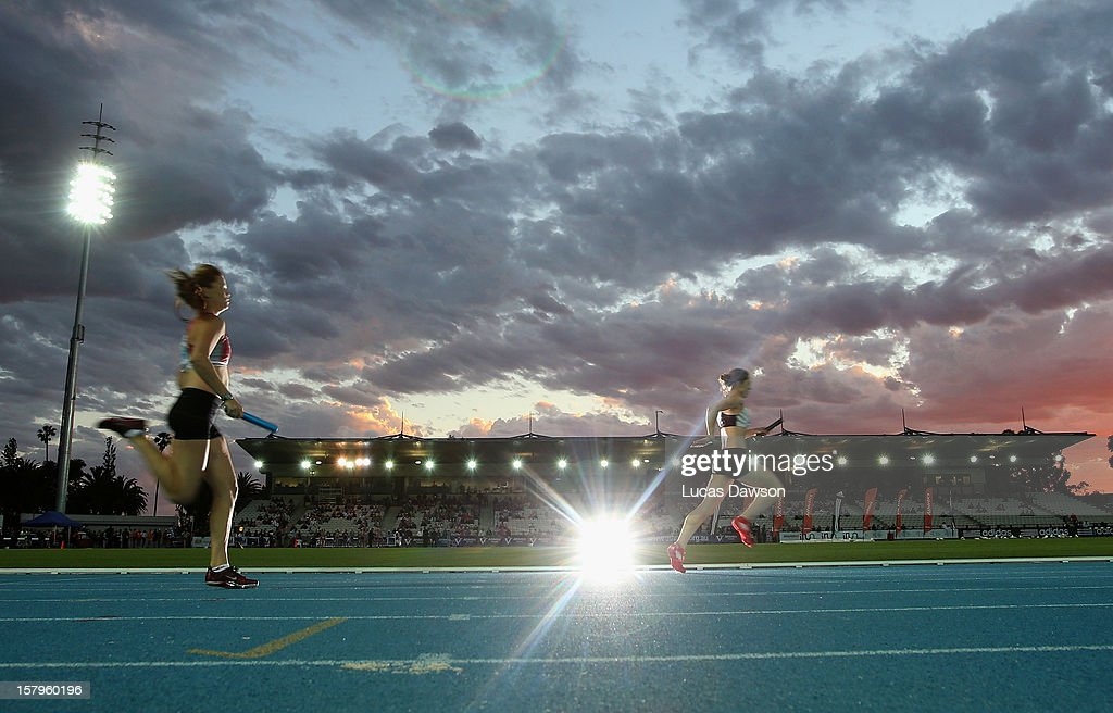 Athletes compete during the Women 4x400 Meter Relay during the Zatopek Classic at Lakeside Stadium on December 8, 2012 in Melbourne, Australia.