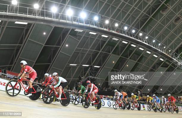 Athletes compete during the women' scratch competition of the UCI Track Cycling World Championships on February 27 2019 in Pruszkow Poland