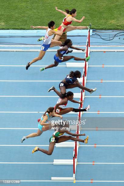 Athlete's compete during the women's 100 metres hurdles heats during day seven of 13th IAAF World Athletics Championships at Daegu Stadium on...