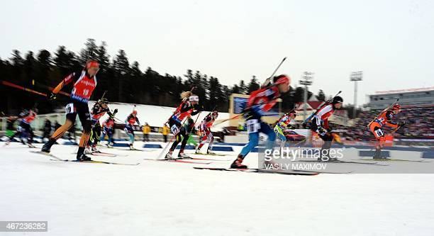 Athletes compete during the women's 125 km mass start event of the Biathlon Word Cup in the Siberian city of KhantyMansiysk on March 22 2015 AFP...