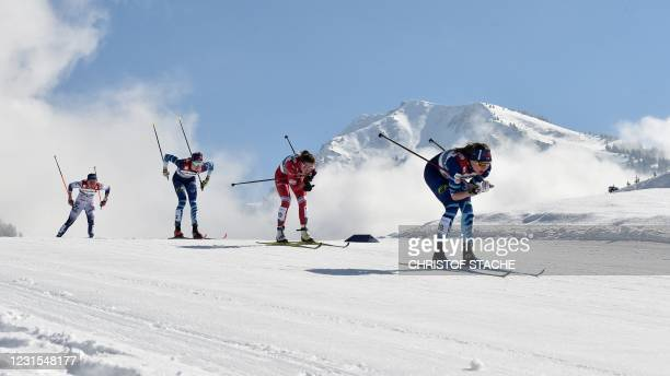 Athletes compete during the women's 30 km mass start race at the FIS Nordic Ski World Championships in Oberstdorf, southern Germany, on March 6, 2021.