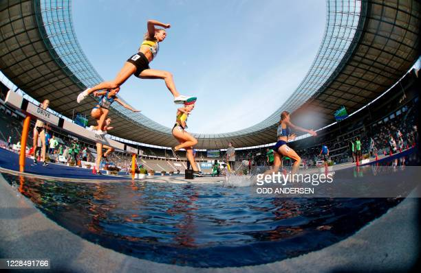 Athletes compete during the women's 3000m steeplechase event of the 79th ISTAF international athletics meeting on September 13, 2020 at the Olympic...