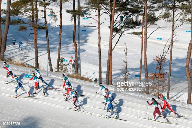 TOPSHOT Athletes compete during the women's 30km cross country mass start classic at the Alpensia cross country ski centre during the Pyeongchang...
