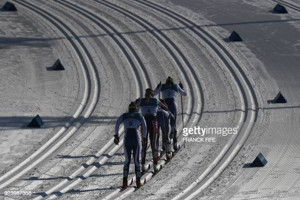 Athletes compete during the women's 30km cross country mass start classic at the Alpensia cross country ski centre during the Pyeongchang 2018 Winter...