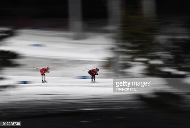 TOPSHOT Athletes compete during the women's 4x5km classic free style cross country relay at the Alpensia cross country ski centre during the...