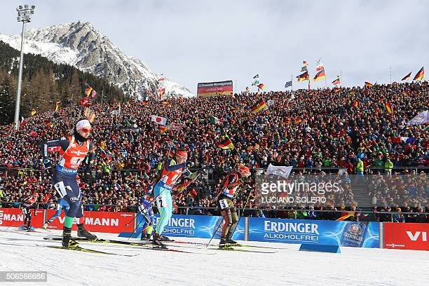 Athletes compete during the Women's 4x6km Relay of the IBU Biathlon World Cup in AntholzAnterselva Italy on January 24 2016 AFP PHOTO / LUCIANO...