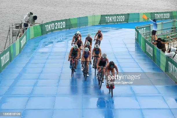 Athletes compete during the Women's Individual Triathlon on day four of the Tokyo 2020 Olympic Games at Odaiba Marine Park on July 27, 2021 in Tokyo,...