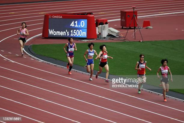 Athletes compete in a heat of the women's 1500m T20 category during a para-athletics test event for the 2020 Tokyo Olympics at the National Stadium...