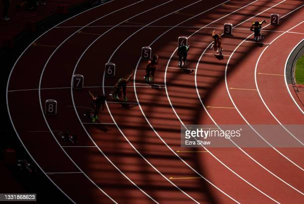 Athletes compete in round one of the Women's 200m heats on day ten of the Tokyo 2020 Olympic Games at Olympic Stadium on August 02, 2021 in Tokyo,...