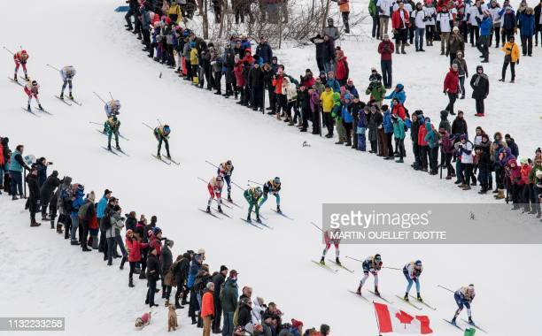 Athletes compete in the 15K Classic Mass StartMen on March 23 during the second day of the FIS CrossCountry World Cup finals in Quebec City Canada