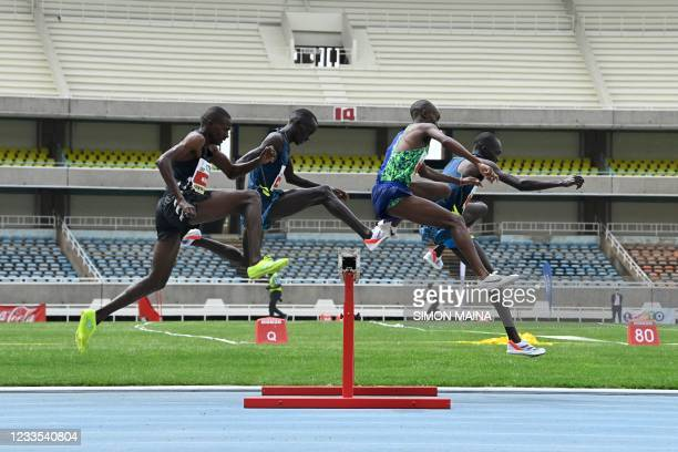 Athletes compete in the 3000M steeple chase men's final on the last day of the trials for the Tokyo Olympic games at the Kasarani stadium in Nairobi...