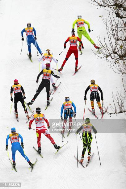 Athletes compete in the 6x 08 kilometer women's team sprint of the FIS Cross Country World Cup at the Dusseldorf city circuit on December 4 2011 in...