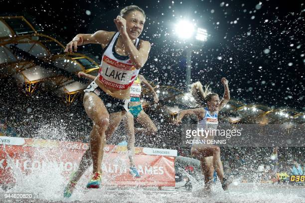 Athletes compete in the athletics women's 3000m steeplechase final during the 2018 Gold Coast Commonwealth Games at the Carrara Stadium on the Gold...