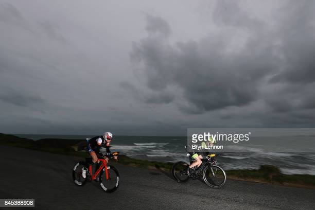 Athletes compete in the bike leg of IRONMAN Wales on September 10 2017 in Tenby Wales