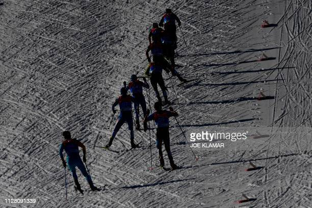 Athletes compete in the cross-country competition of the men's Nordic Combined Individual Gundersen NH/10 km event at the FIS Nordic World Ski...