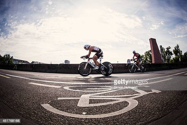 Athletes compete in the cycling during the Ironman Frankfurt on July 6 2014 in Frankfurt am Main Germany