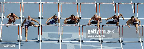 Athletes compete in the first round heat 3 of the men's 110m hurdles at the 2010 European Athletics Championships at the Olympic Stadium in Barcelona...