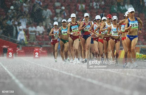 Athletes compete in the heavy rain during the Women's 20km Walk Final held at the National Stadium during Day 13 of the Beijing 2008 Olympic Games on...