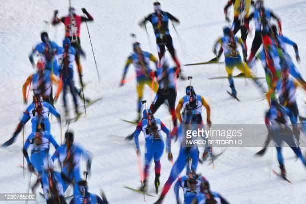 Athletes compete in the IBU Biathlon World Cup Men'S 15km Mass Start Competition in Antholz-Anterselva, Italian Alps, on January 24, 2021.
