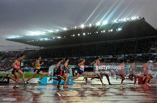 Athletes compete in the Men's 10000 Metres Final during day four of the 21st European Athletics Championships at the Olympic Stadium on June 30 2012...
