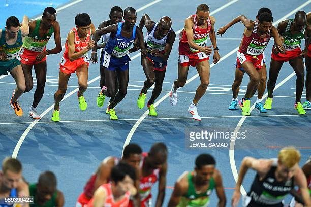 Athletes compete in the Men's 10000m during the athletics event at the Rio 2016 Olympic Games at the Olympic Stadium in Rio de Janeiro on August 13...