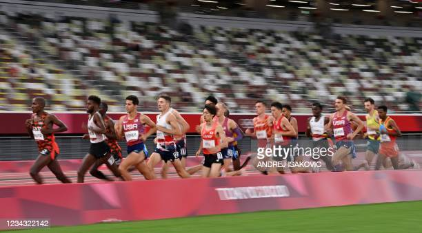 Athletes compete in the men's 10000m final during the Tokyo 2020 Olympic Games at the Olympic Stadium in Tokyo on July 30, 2021.