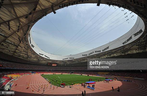 Athletes compete in the Men's 100m during the Good Luck Beijing 2008 China Athetics Open at the National Stadium, better known as the Bird's Nest, on...