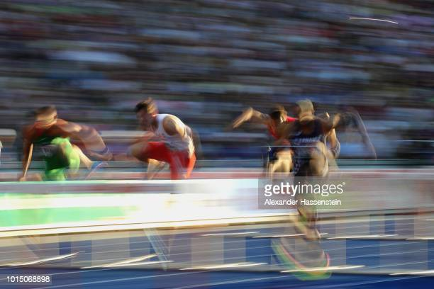 Athletes compete in the Men's 110m Hurdles semifinal during day four of the 24th European Athletics Championships at Olympiastadion on August 10 2018...