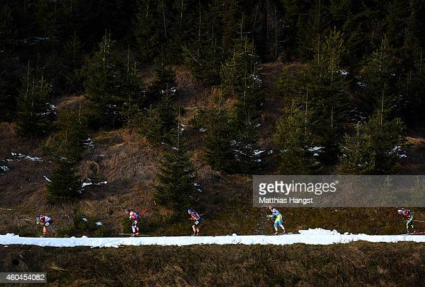 Athletes compete in the men's 12,5 km pursuit event during the IBU Biathlon World Cup on December 14, 2014 in Hochfilzen, Austria.