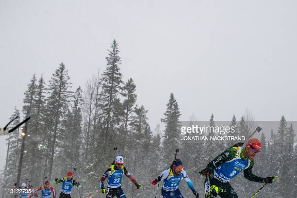 Athletes compete in the men's 15 km mass start event at the IBU World Biathlon Championships in Oestersund, Sweden, on March 17, 2019.