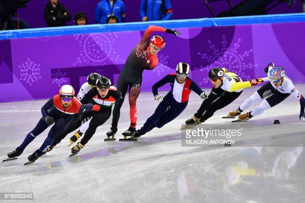 Athletes compete in the men's 1,500m short track speed skating semi-final event during the Pyeongchang 2018 Winter Olympic Games, at the Gangneung...