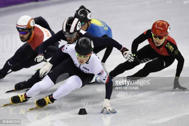 Athletes compete in the men's 1500m short track speed skating heat event during the Pyeongchang 2018 Winter Olympic Games at the Gangneung Ice Arena...
