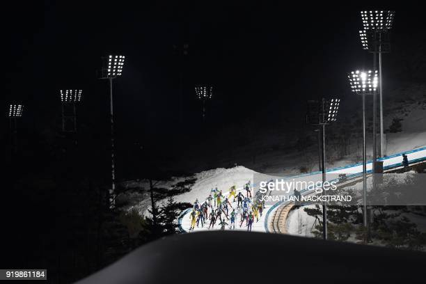 TOPSHOT Athletes compete in the men's 15km mass start biathlon event during the Pyeongchang 2018 Winter Olympic Games on February 18 in Pyeongchang /...