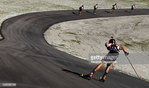 Athletes compete in the men's 20 km individual event during the German Championships at the Chiemgau Arena on September 16, 2011 in Ruhpolding,...