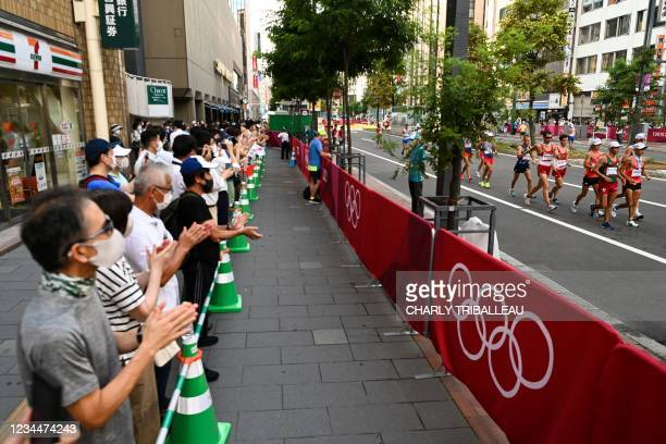 Athletes compete in the men's 20km race walk final during the Tokyo 2020 Olympic Games at the Sapporo Odori Park in Sapporo on August 5, 2021.