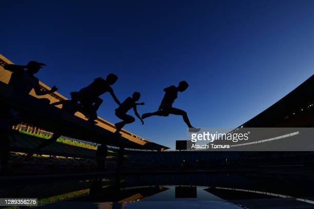 Athletes compete in the men's 3000 meters Steeplechase during the JAAF Athletics Championships Distance Events at Yanmar Stadium Nagai on December...