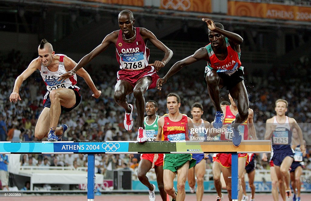 Athletes compete in the men's 3,000 metre steeplechase on August 21, 2004 during the Athens 2004 Summer Olympic Games at the Olympic Stadium in the Sports Complex in Athens, Greece.