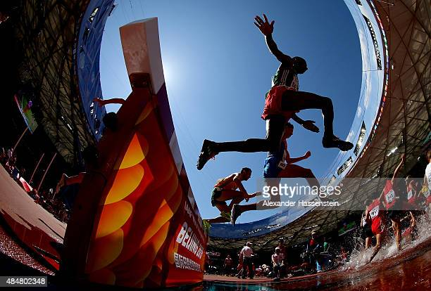 Athletes compete in the Men's 3000 metres steeplechase heats during day one of the 15th IAAF World Athletics Championships Beijing 2015 at Beijing...