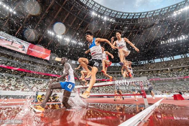 Athletes compete in the men's 3000m steeple-chase during an athletics test event for the 2020 Tokyo Olympics at the National Stadium in Tokyo on May...