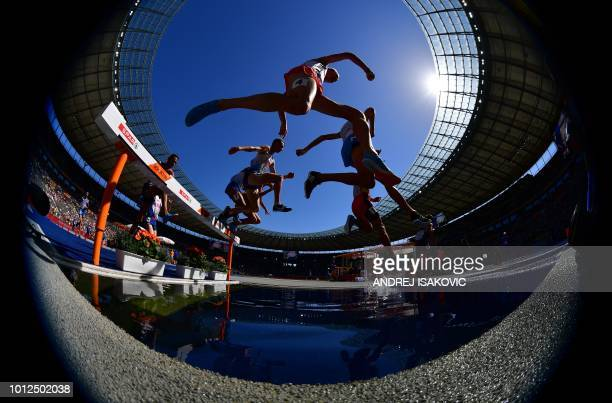 Athletes compete in the men's 3000m steeplechase event during the European Athletics Championships in Berlin on August 7 2018