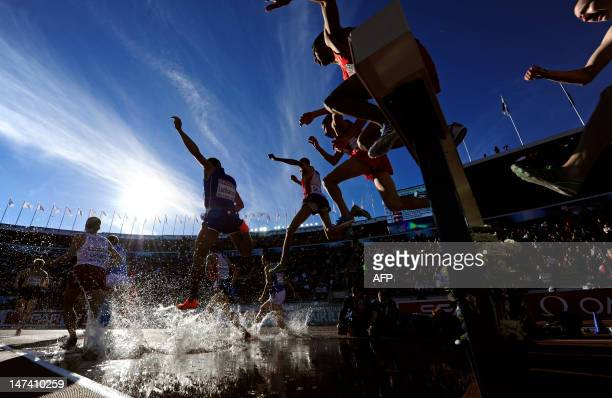 Athletes compete in the men's 3000m steeplechase final at the 2012 European Athletics Championships at the Olympic Stadium in Helsinki on June 29,...