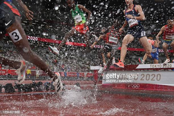 Athletes compete in the men's 3000m steeplechase final during the Tokyo 2020 Olympic Games at the Olympic Stadium in Tokyo on August 2, 2021.
