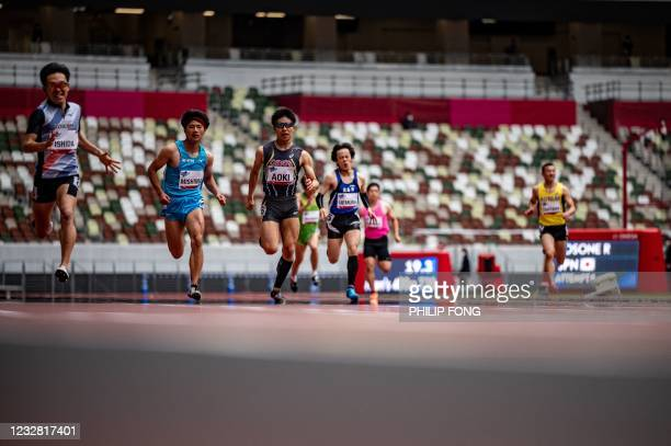 Athletes compete in the men's 400m - T20 category during a para-athletics test event for the 2020 Tokyo Olympics at the National Stadium in Tokyo on...