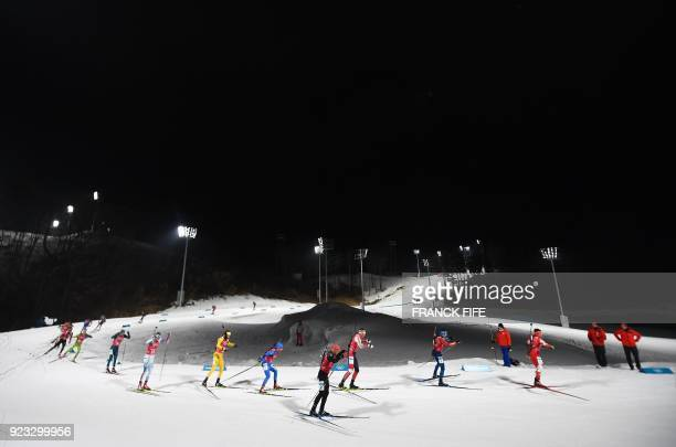 TOPSHOT Athletes compete in the men's 4x75km biathlon event during the Pyeongchang 2018 Winter Olympic Games on February 23 in Pyeongchang / AFP...