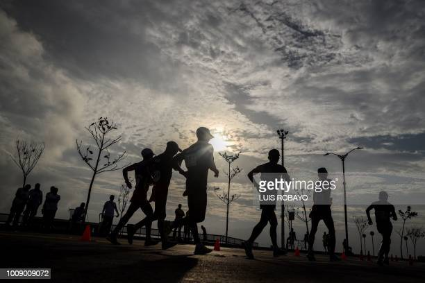 Athletes compete in the Men's 50 Km Race Walk during the 2018 Central American and Caribbean Games in Barranquilla Colombia on August 1 2018