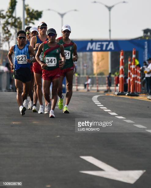 Athletes compete in the Men's 50 Km Walk race during the 2018 Central American and Caribbean Games in Barranquilla Colombia on August 1 2018