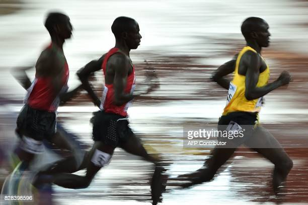 TOPSHOT Athletes compete in the men's 5000m athletics event at the 2017 IAAF World Championships at the London Stadium in London on August 9 2017 /...