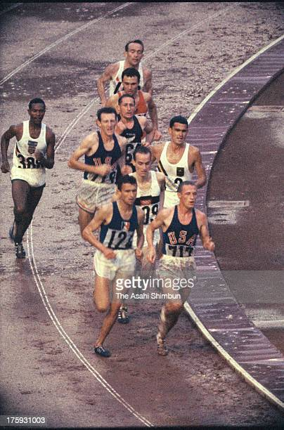 Athletes compete in the Men's 5000m Final at the National Stadium during the Tokyo Olympic on October 18 1964 in Tokyo Japan